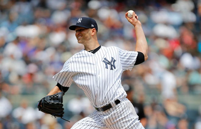 New York Yankees starting pitcher J.A. Happ (34) pitches against Kansas City Royals in the second inning at Yankee Stadium.