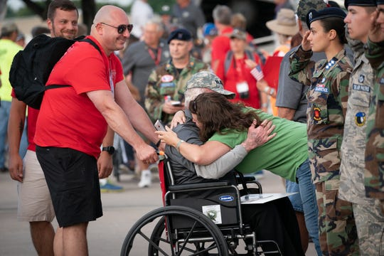 One veteran gets an emotional welcome at a welcome-home reception at the EAA AirVenture in Oshkosh for the Old Glory Honor Flight on July 27.
