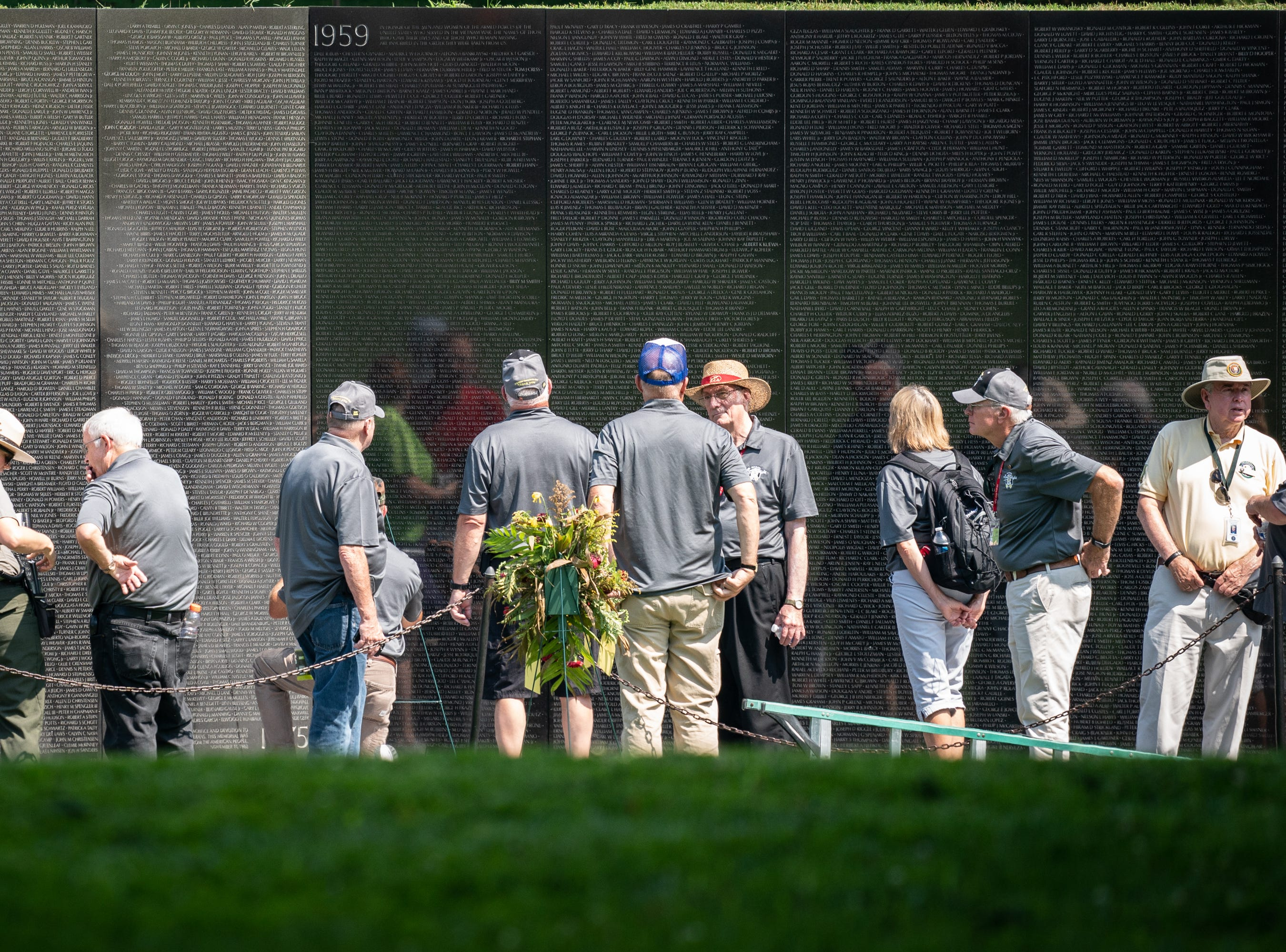 Veterans gather at the Vietnam Veterans Memorial in Washington, D.C.., as part of the July 27 Yellow Ribbon Honor Flight from the EAA Convention in Oshkosh. The group visited the memorial, The Smithsonian Museum, Arlington National Cemetery and the Air Force Memorial before returning to AirVenture for a welcome-home ceremony.