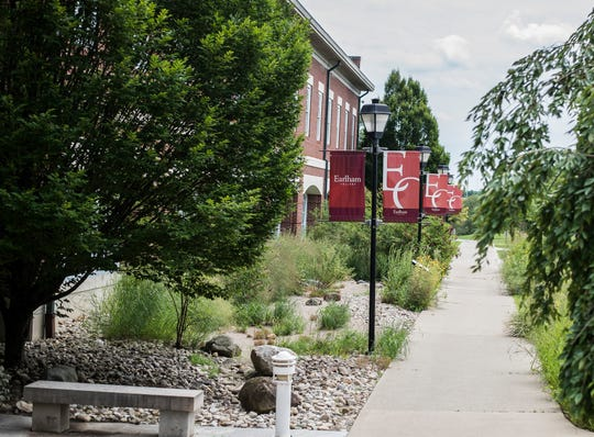 Signage for Earlham College is seen on the campus on July 26, 2018.