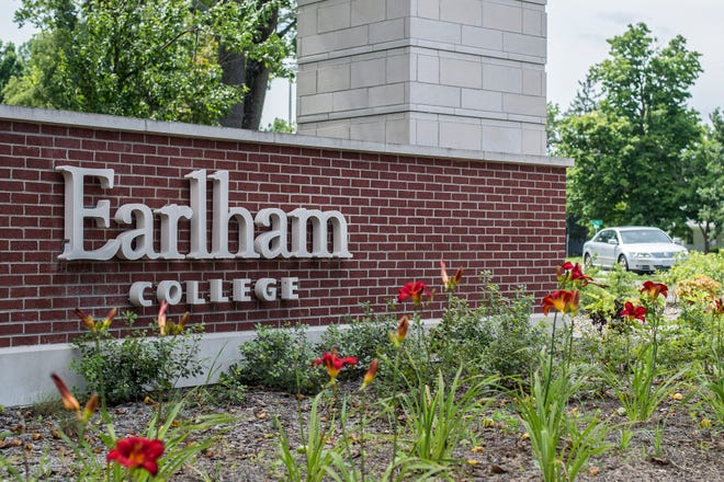 Signage for Earlham College is seen by an entrance to campus on July 26, 2018.