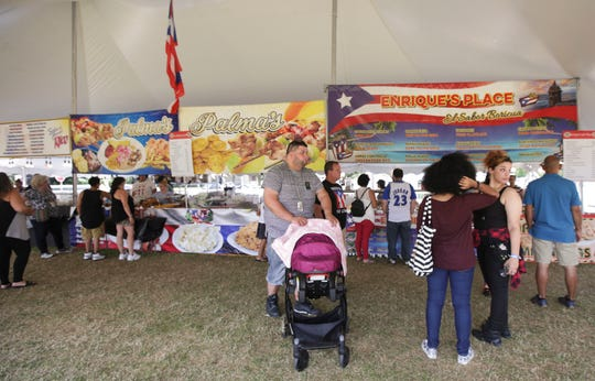 Inside of the food tent at the 49th annual Puerto Rican Festival on Sunday, July 29.