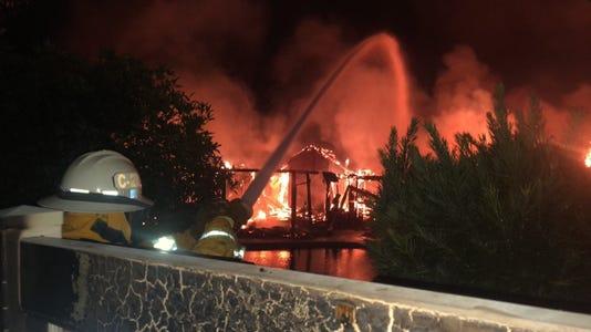 John Kaylor battles a blaze in Sunset West neighborhood
