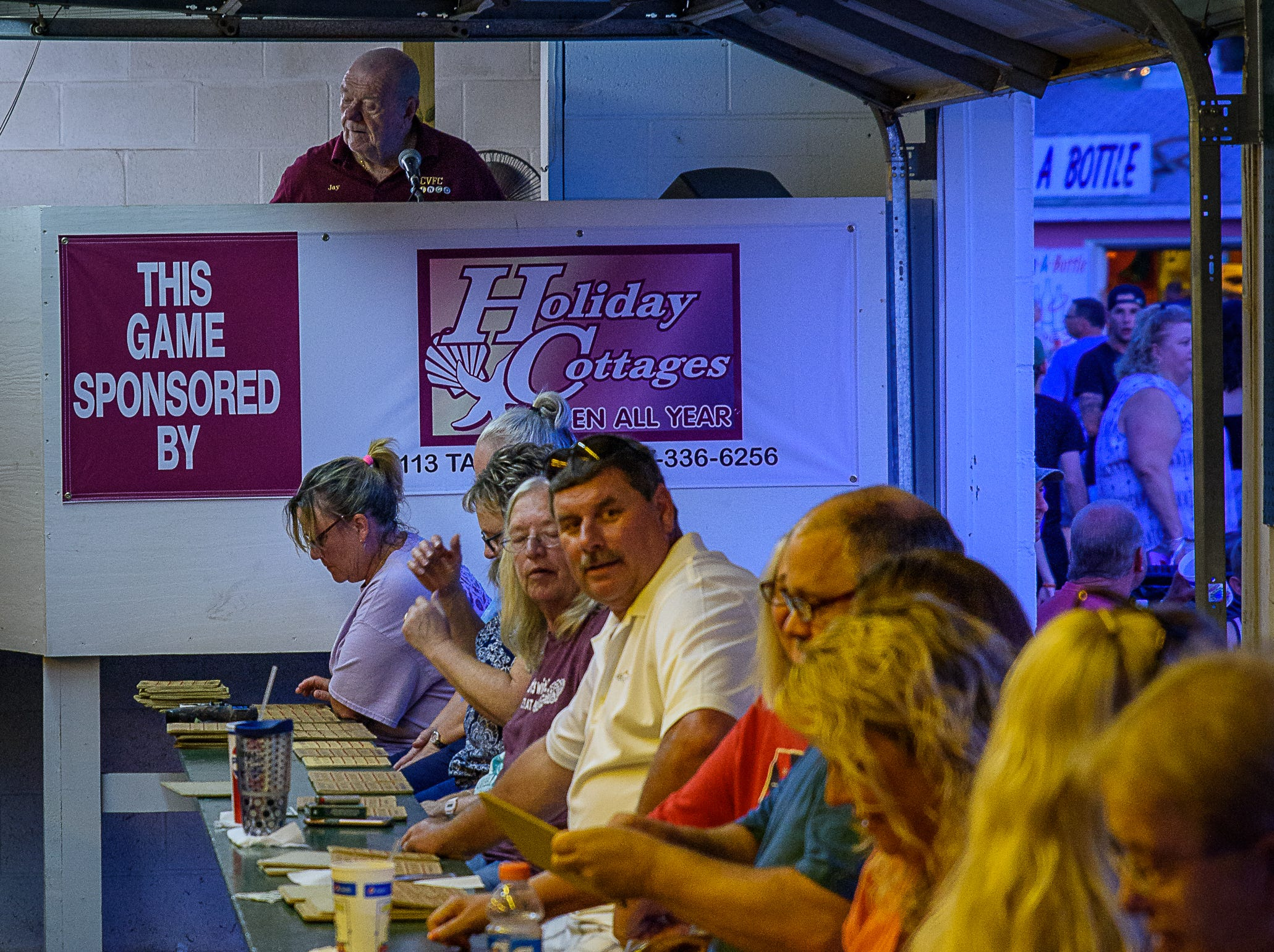 Bingo players lined up at their benches in front of the caller at the Chincoteague Fireman's Carnival.