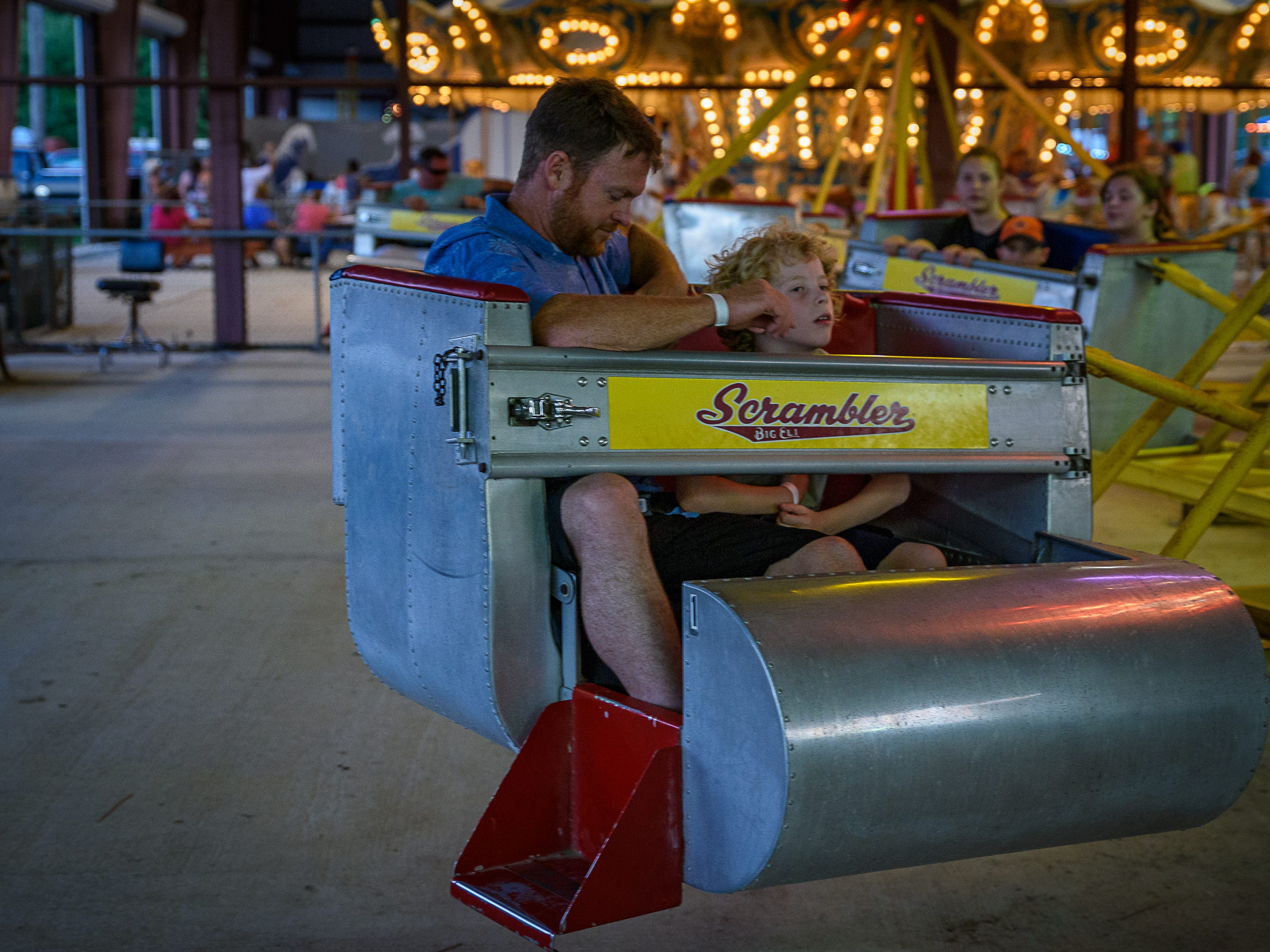 Two fair-goers, being spun on The Scrambler at the Chincoteague Fireman's Carnival.