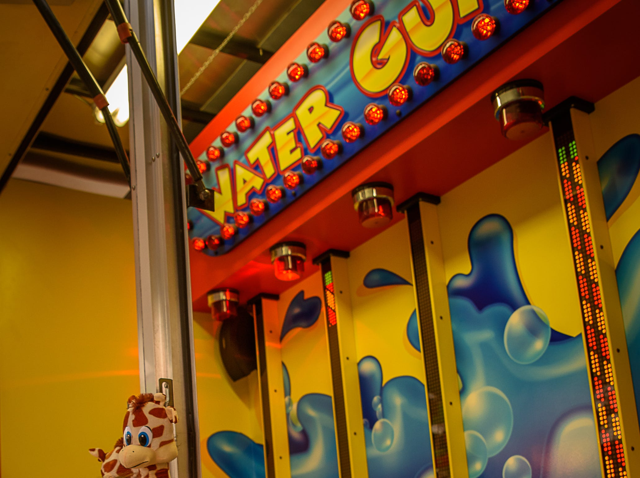 The water gun game was a popular attraction at the fair at the Chincoteague Fireman's Carnival.