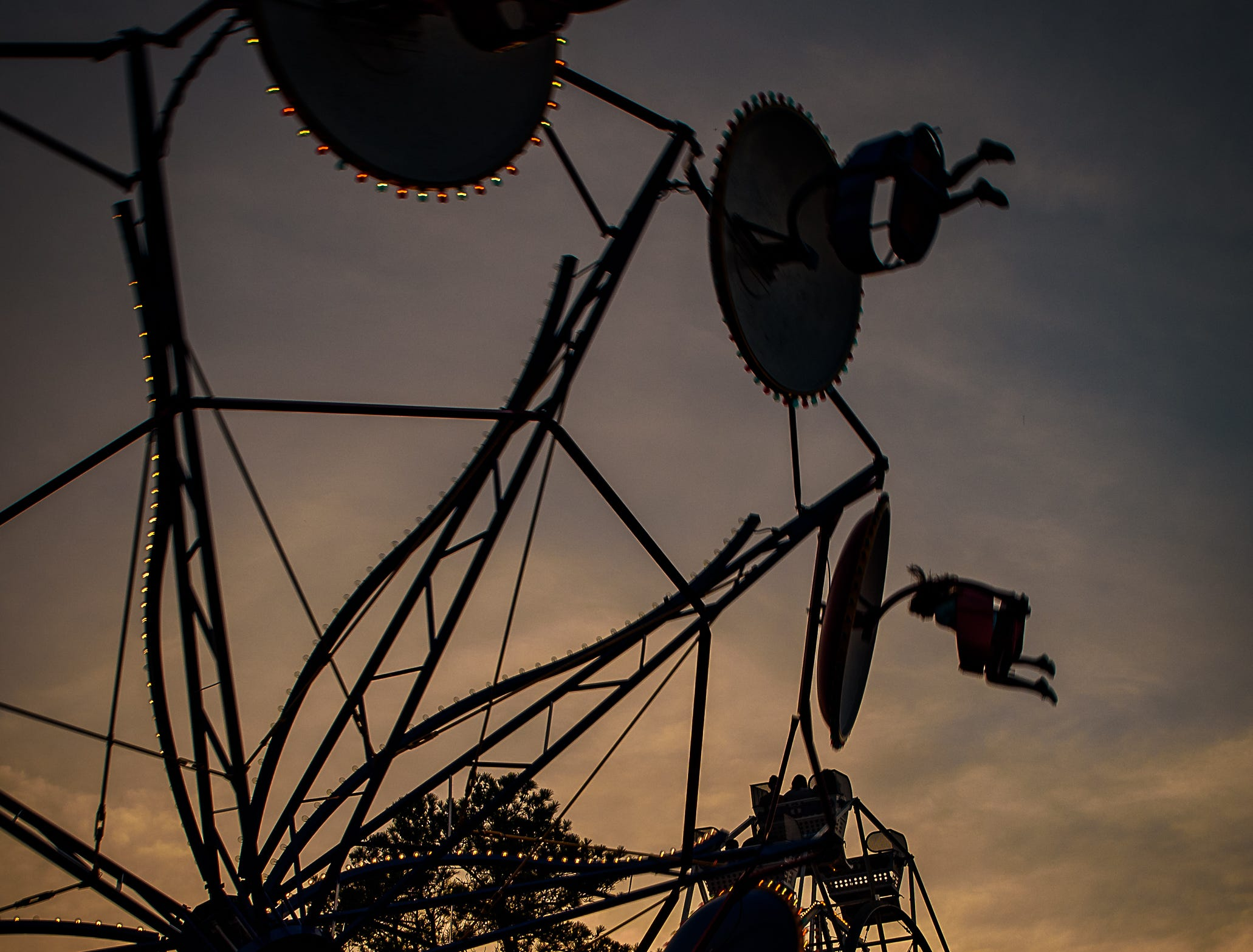 The Ferris Wheels and The Paratrooper against the Chincoteague sunset at the Chincoteague Fireman's Carnival.