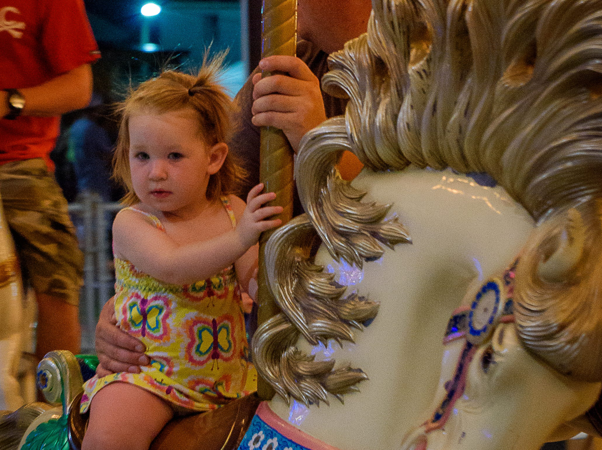 A very young fair-goer enjoying the carousel at the Chincoteague Fireman's Carnival.
