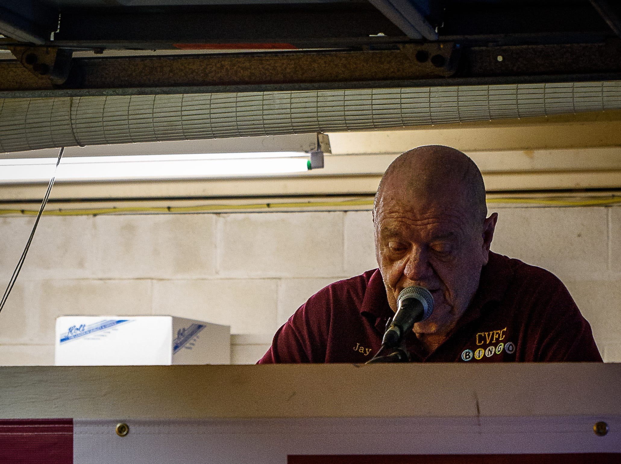 A Fire Department Volunteer calls the Bingo numbers at the Chincoteague Fireman's Carnival.