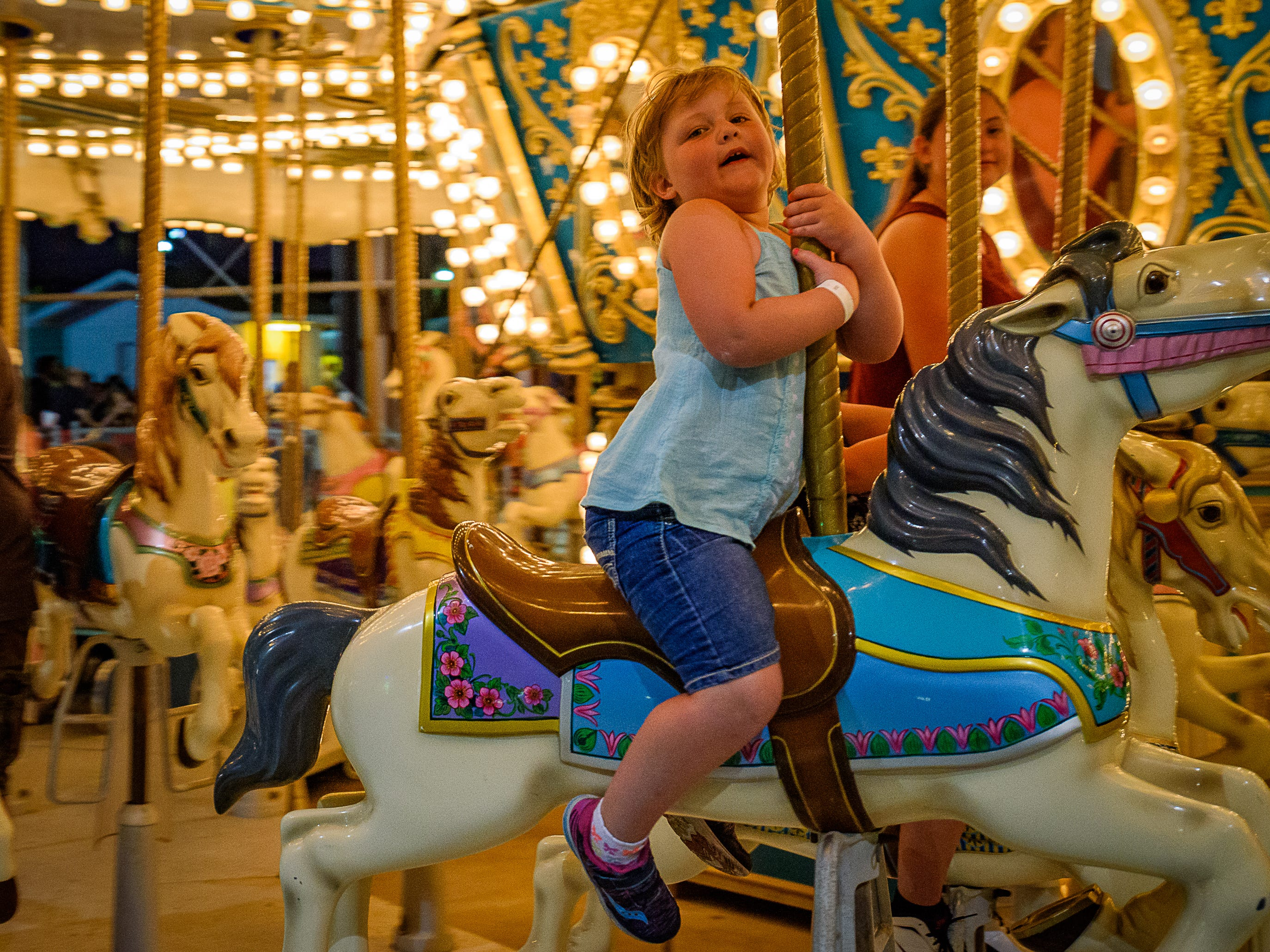 A young visitor to the fair enjoys the carousel at the Chincoteague Fireman's Carnival.