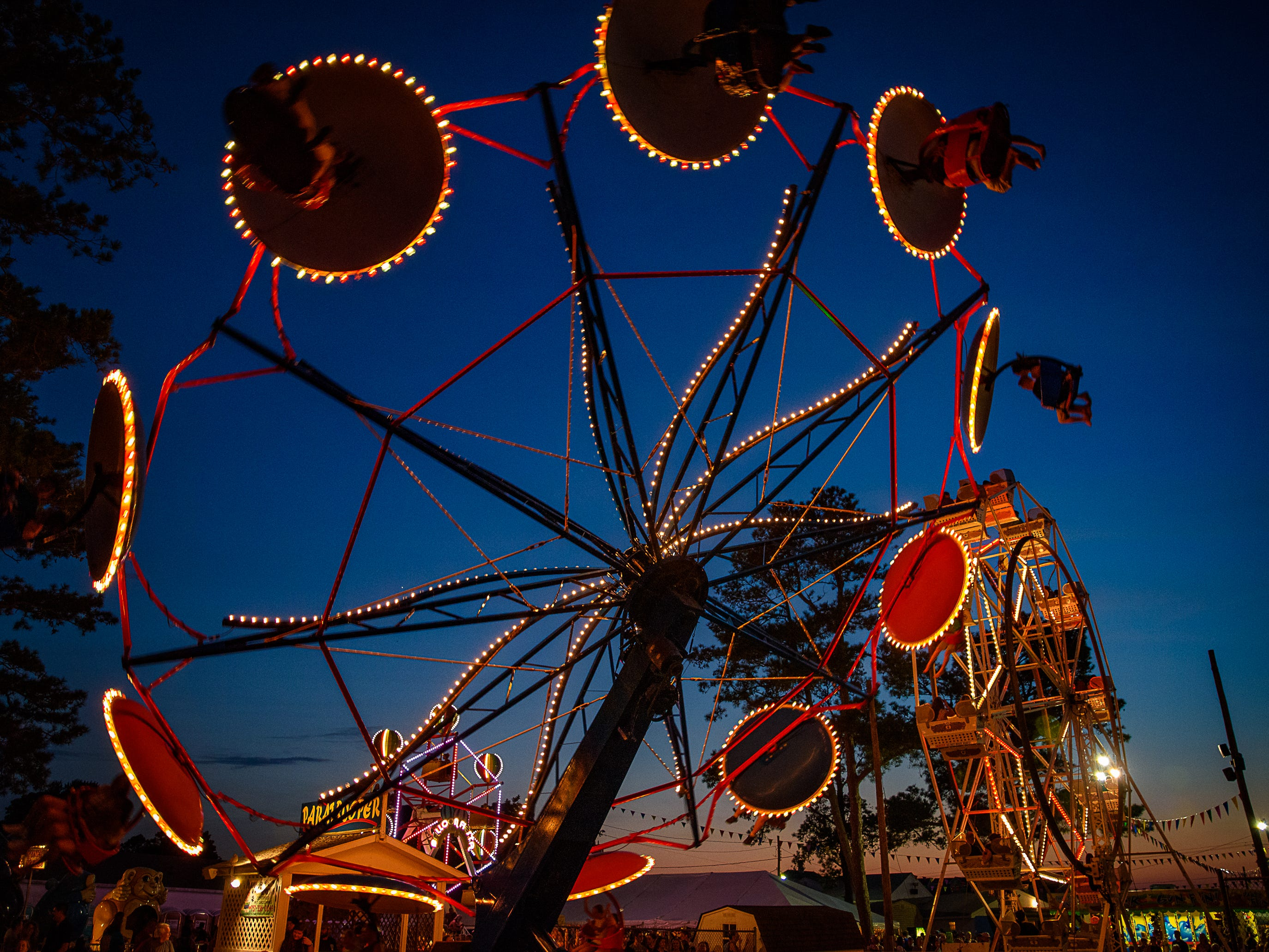 The Paratrooper and the Ferris Wheel. Two of the Fairs most popular attractions, against Chincoteague's night sky at the Chincoteague Fireman's Carnival.