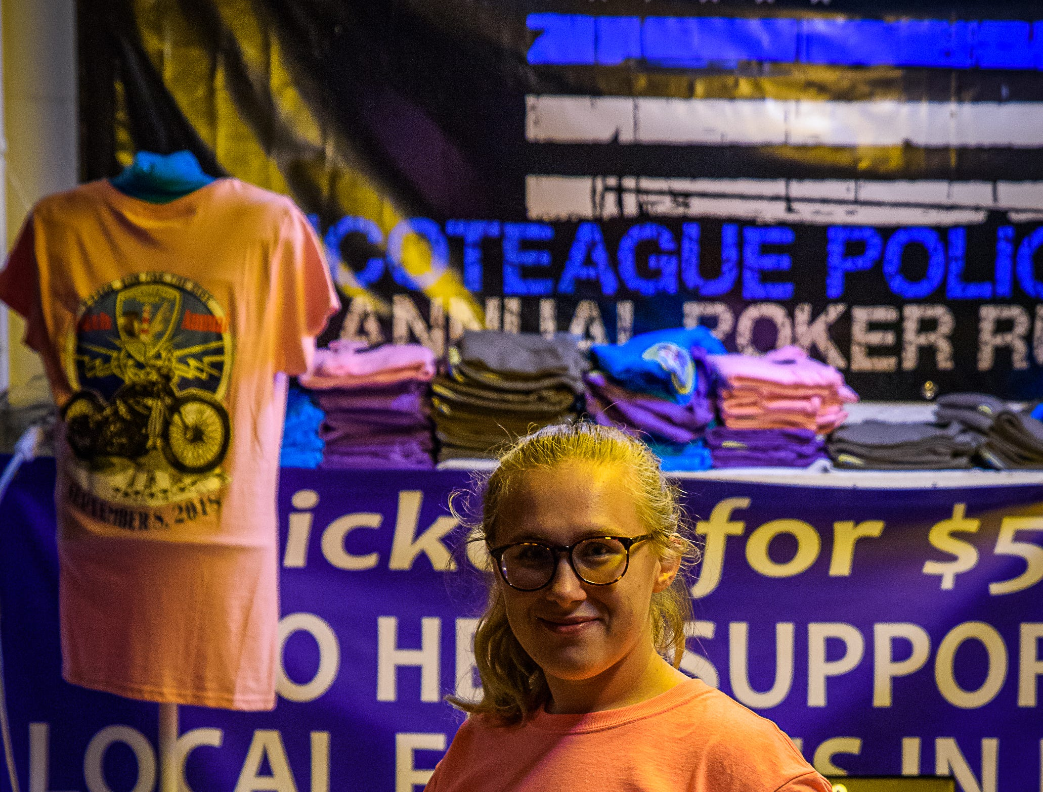 A volunteer at the both for the Chincoteague Police Department booth at the Chincoteague Fireman's Carnival.