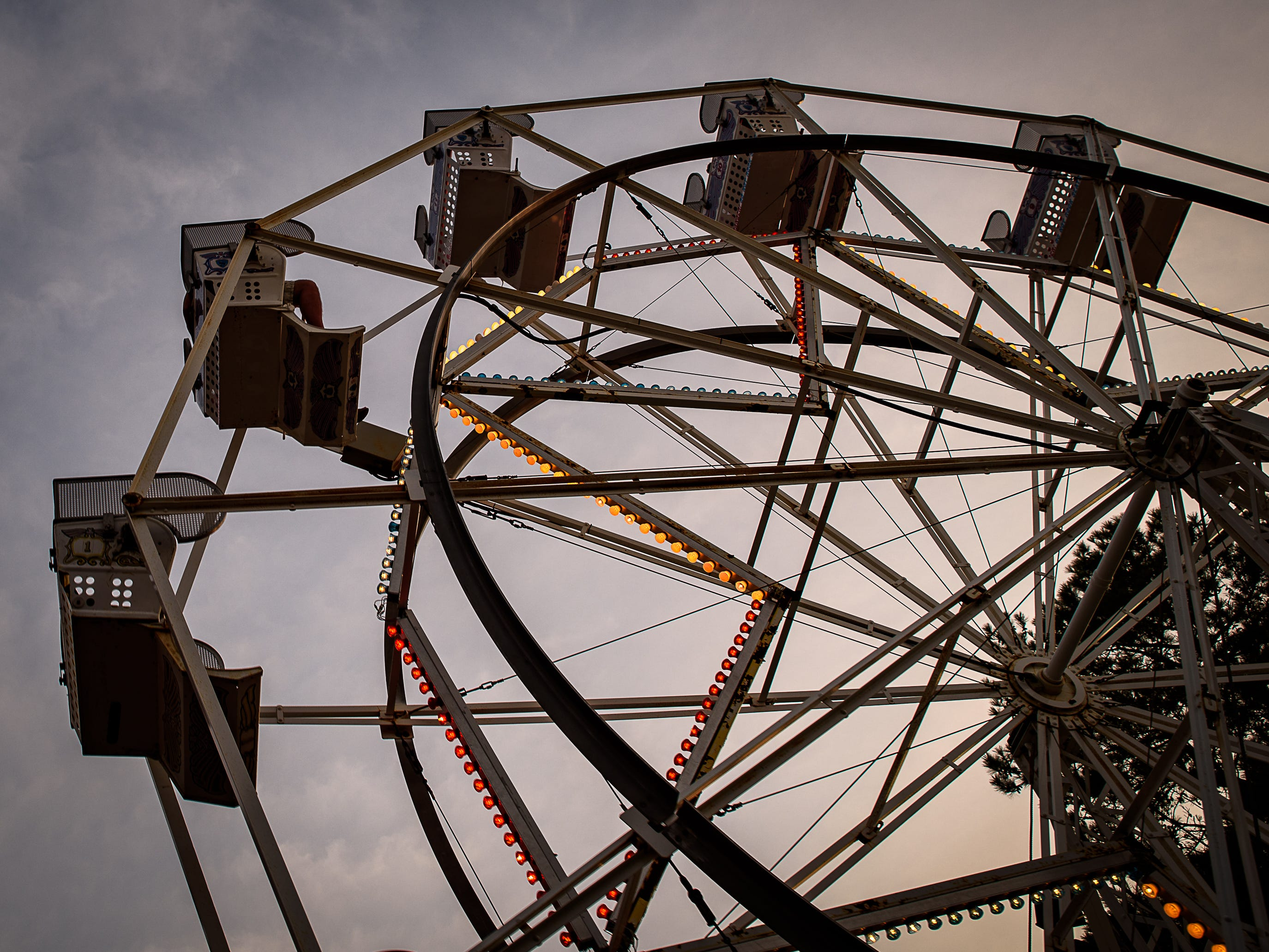 A popular ride, the Ferris Wheel rises into the Chincoteague sky at the Chincoteague Fireman's Carnival.