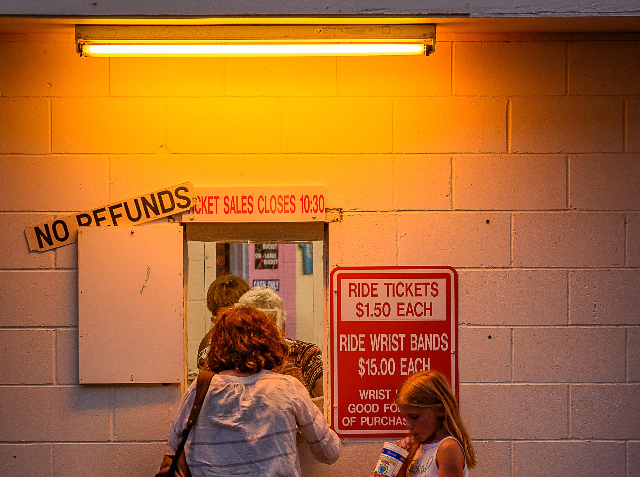 Buying tickets for the evenings festivities at the Chincoteague Fireman's Carnival.
