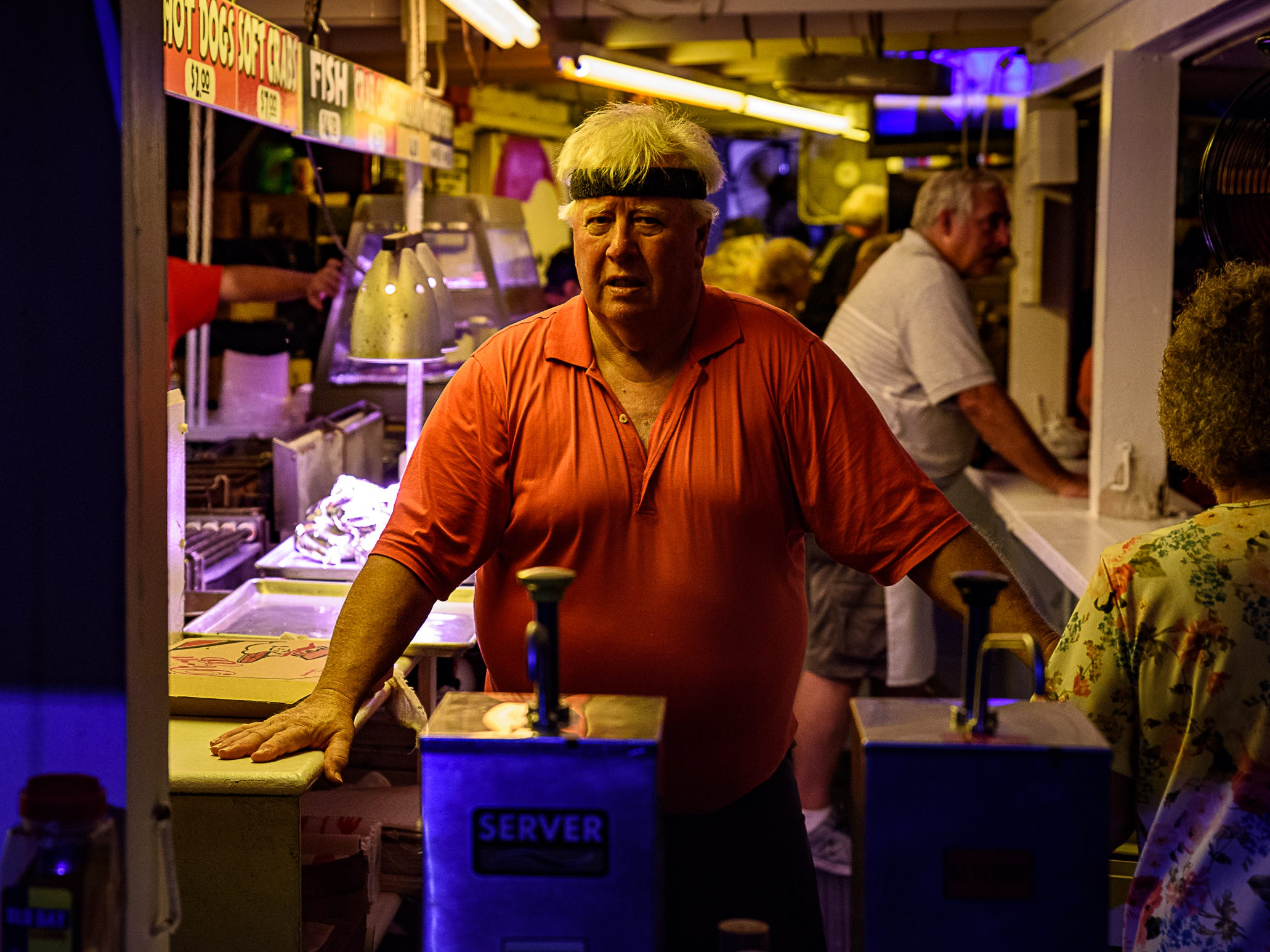 A volunteer at one of the food booths at the Chincoteague Fireman's Carnival.