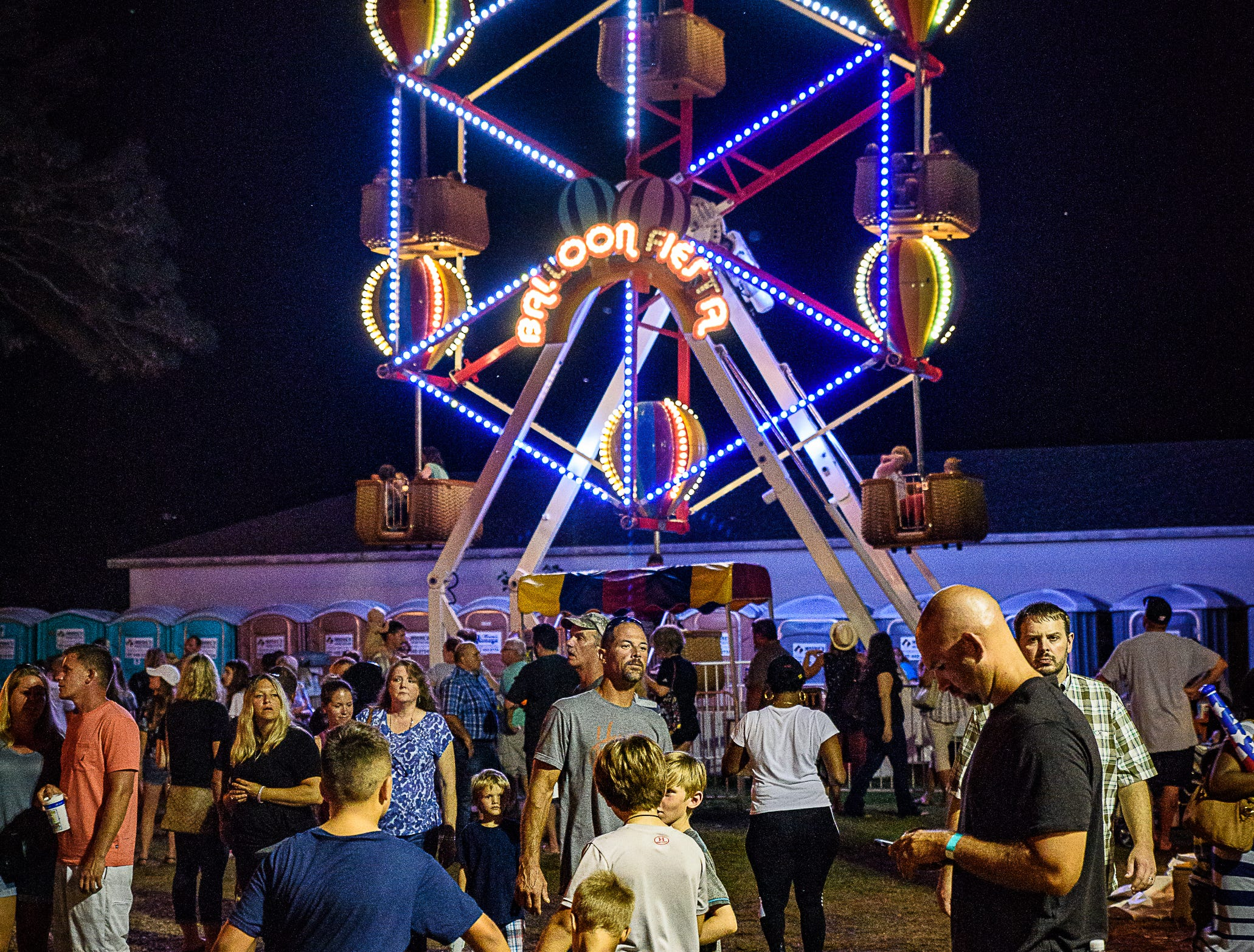 Carnival patrons line up for the Balloon Riesta Ferris Wheel at the Chincoteague Fireman's Carnival.
