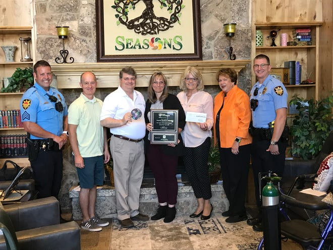 Seasons Healthcare and Rehabilitation in St. George received a membership plaque and grant from Senior Crimestoppers on July 27, 2018. Attendees at the presentation included: St. George police Sgt. David Williams (from left), Town and Country CCO Jon Allen, St. George Branch Manager Brad Stucki, Seasons Director of Nursing Terral Bassett, Town & Country's Wendy Holt, Senior Crimestoppers representative Carol Van Horst and police Lt. Thad Feltner.