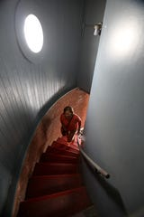 Abby Connett of Dobbs Ferry follows the spiral staircase while touring the Sleepy Hollow Lighthouse during an open house July 29, 2018 at Kingsland Point Park in Sleepy Hollow.