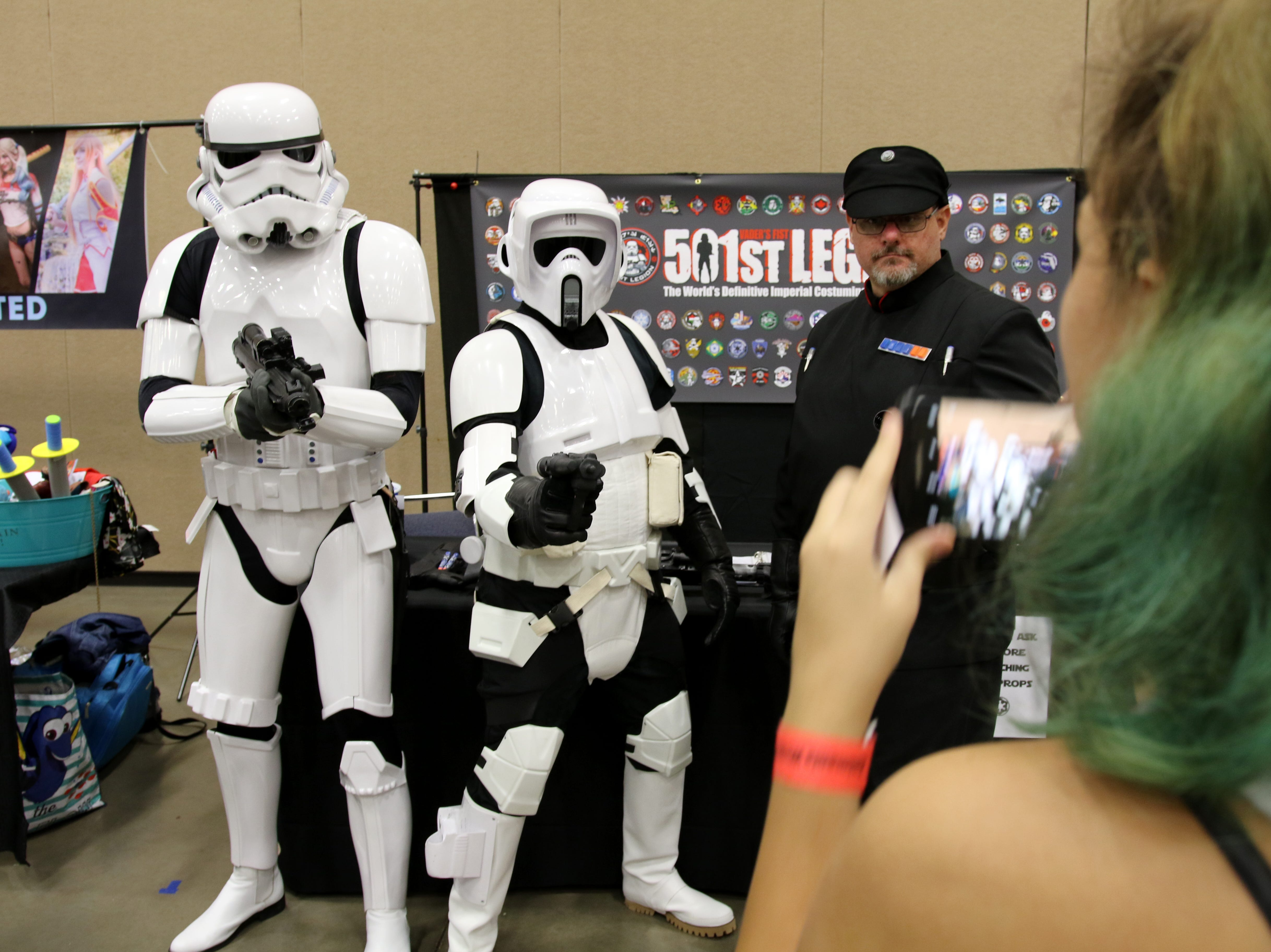 A popular activity at Animania is to take pictures of cosplayers Saturday, July 28, 2018, in the MPEC Ray Clymer Exhibit Hall.