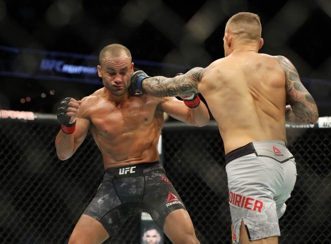 Dustin Poirier, right, fights Eddie Alvarez during UFC Fight Night at Scotiabank Saddledome.