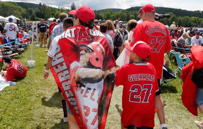 Fans of Vladimir Guerrero attend the Baseball Hall of Fame induction ceremony.