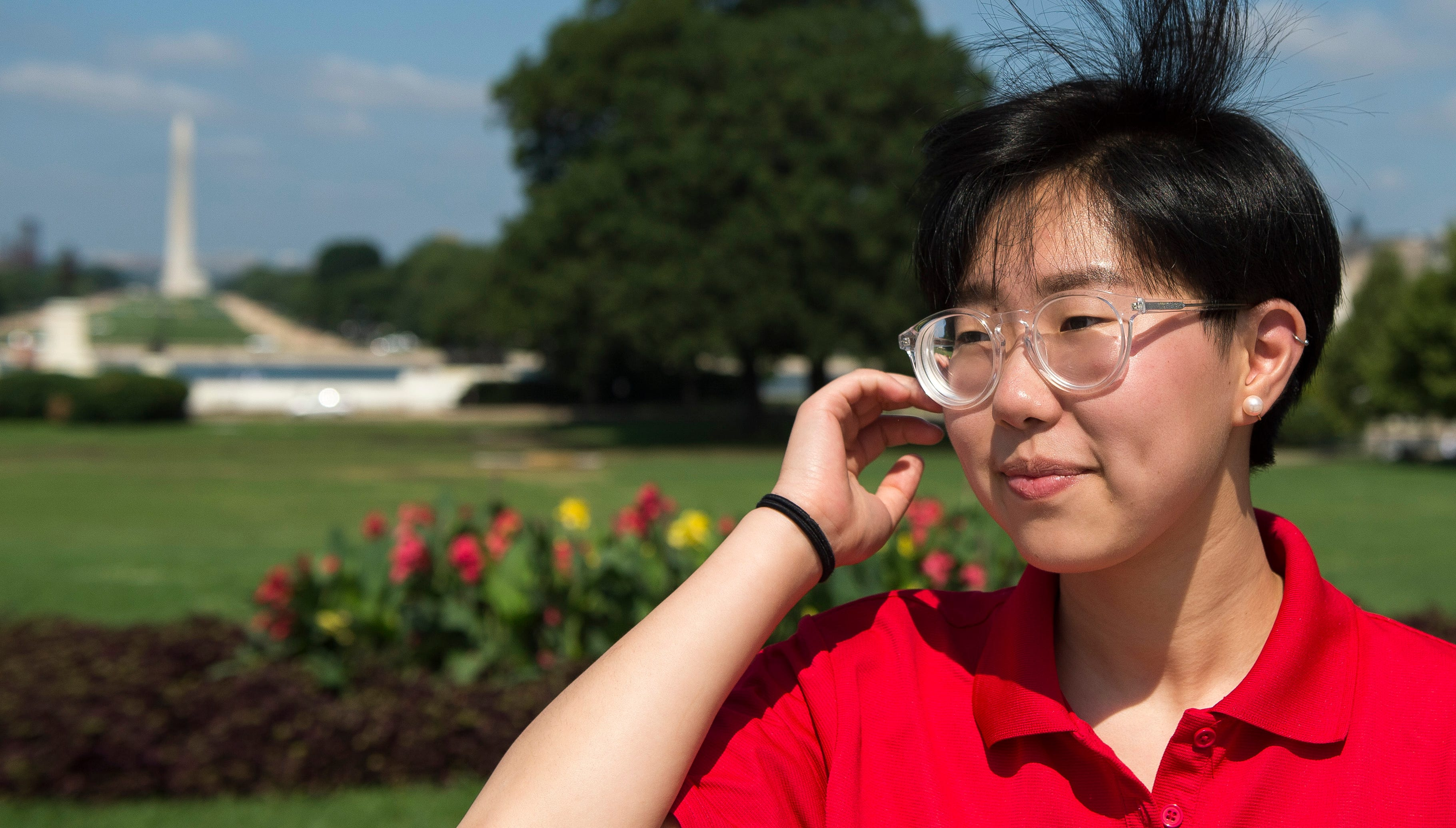 Suzie Cho, 17, from Lincoln, Neb., poses for a portrait in front of the Washington Monument on July 29, 2018.