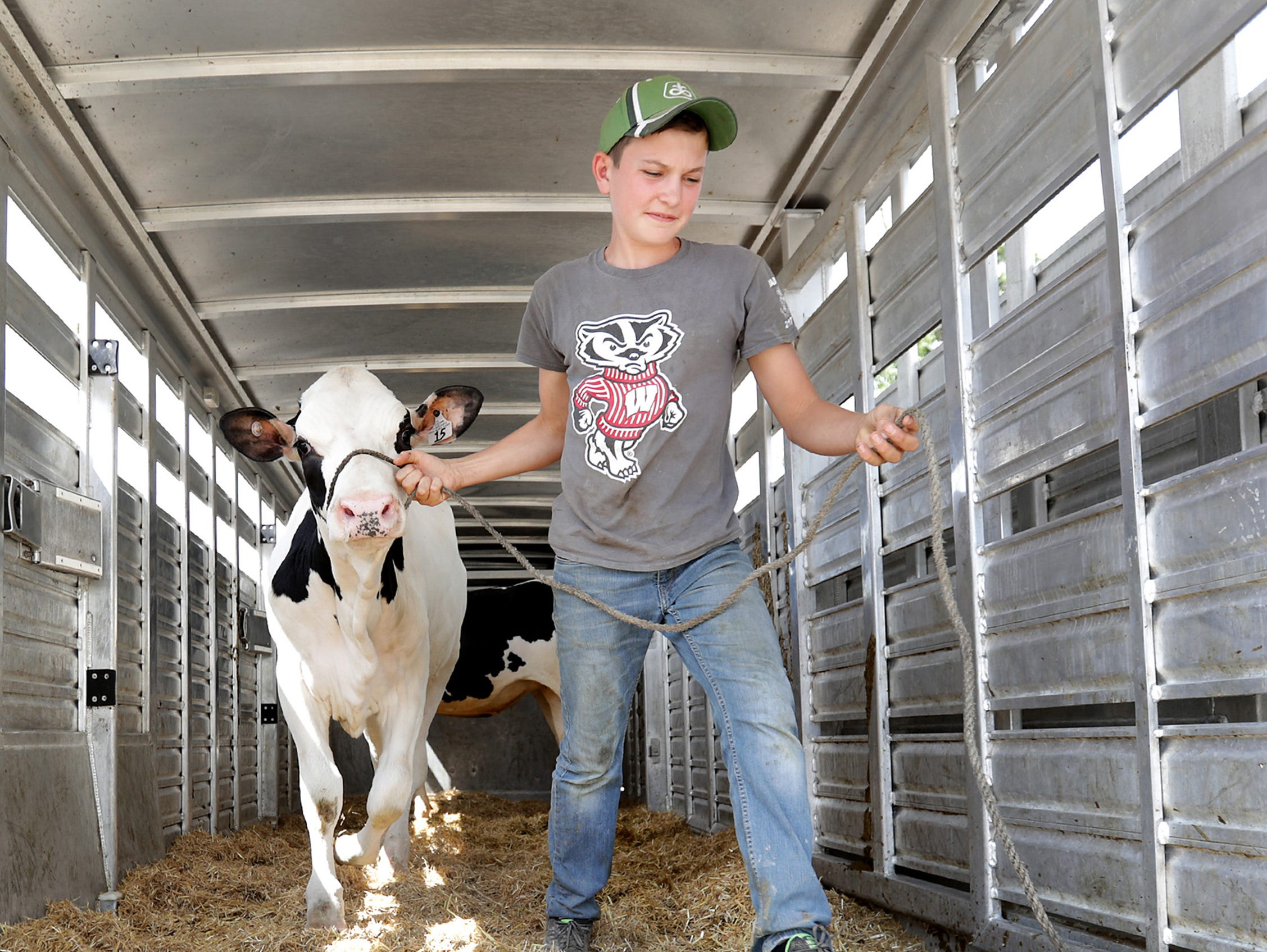 Joe Schuh, Freedom, helps unload a trailer during the Outagamie County Fair on Wednesday, July 25, 2018 in Seymour, Wis. Wm. Glasheen/USA TODAY NETWORK-Wisconsin