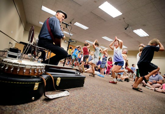 Will Branch and Dave Fox, of Fox & Branch, perform at the Neenah Public Library while their audience dances Tuesday, July 24, 2018, in Neenah, Wis. 