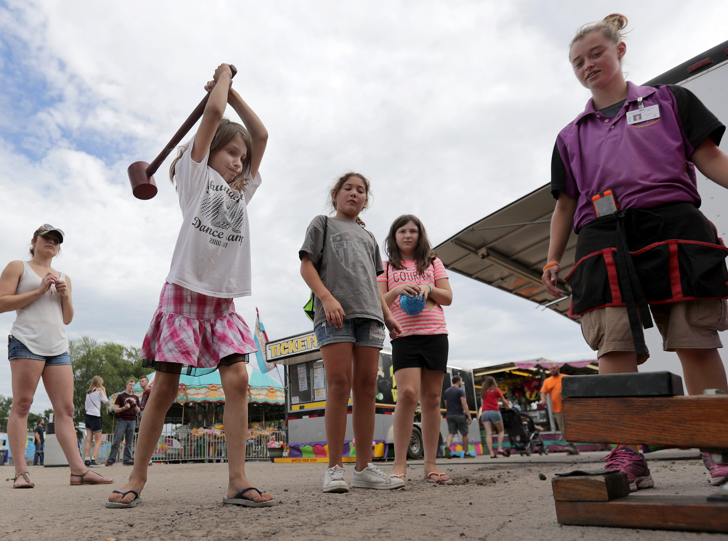 Allie Schroeder tests her strength during the Outagamie County Fair on Wednesday, July 25, 2018 in Seymour, Wis. Wm. Glasheen/USA TODAY NETWORK-Wisconsin
