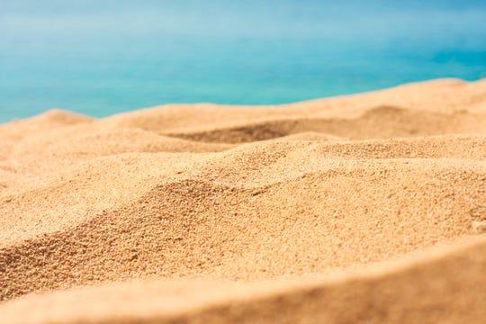Beach sand, sunlight