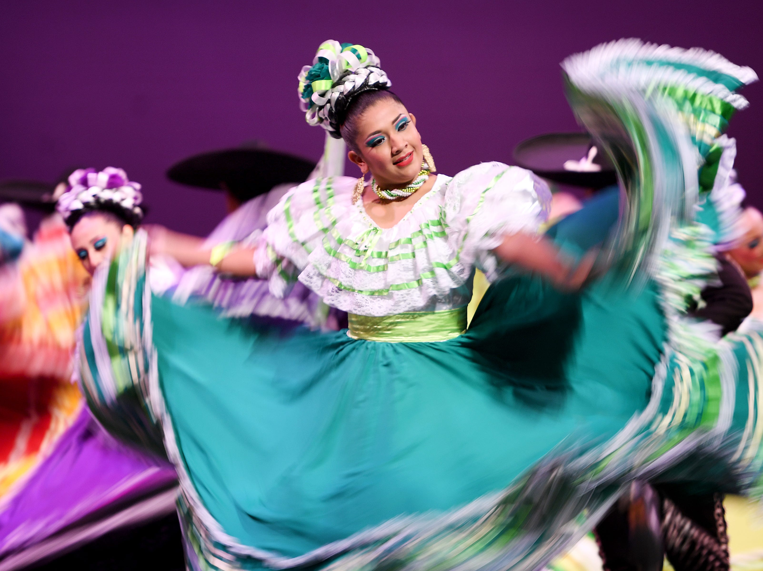 """Members of """"Fiesta Mexicana"""" Ballet Folklorico of Monterrey perform representing Mexico through dance during a Folkmoot Festival performance at the Diana Wortham Theatre on Friday, Aug. 27, 2018."""