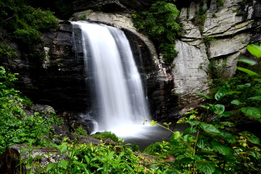Water flows down the 60 feet of Looking Glass Falls in the Pisgah National Forest in Transylvania County on Thursday, July 19, 2018.