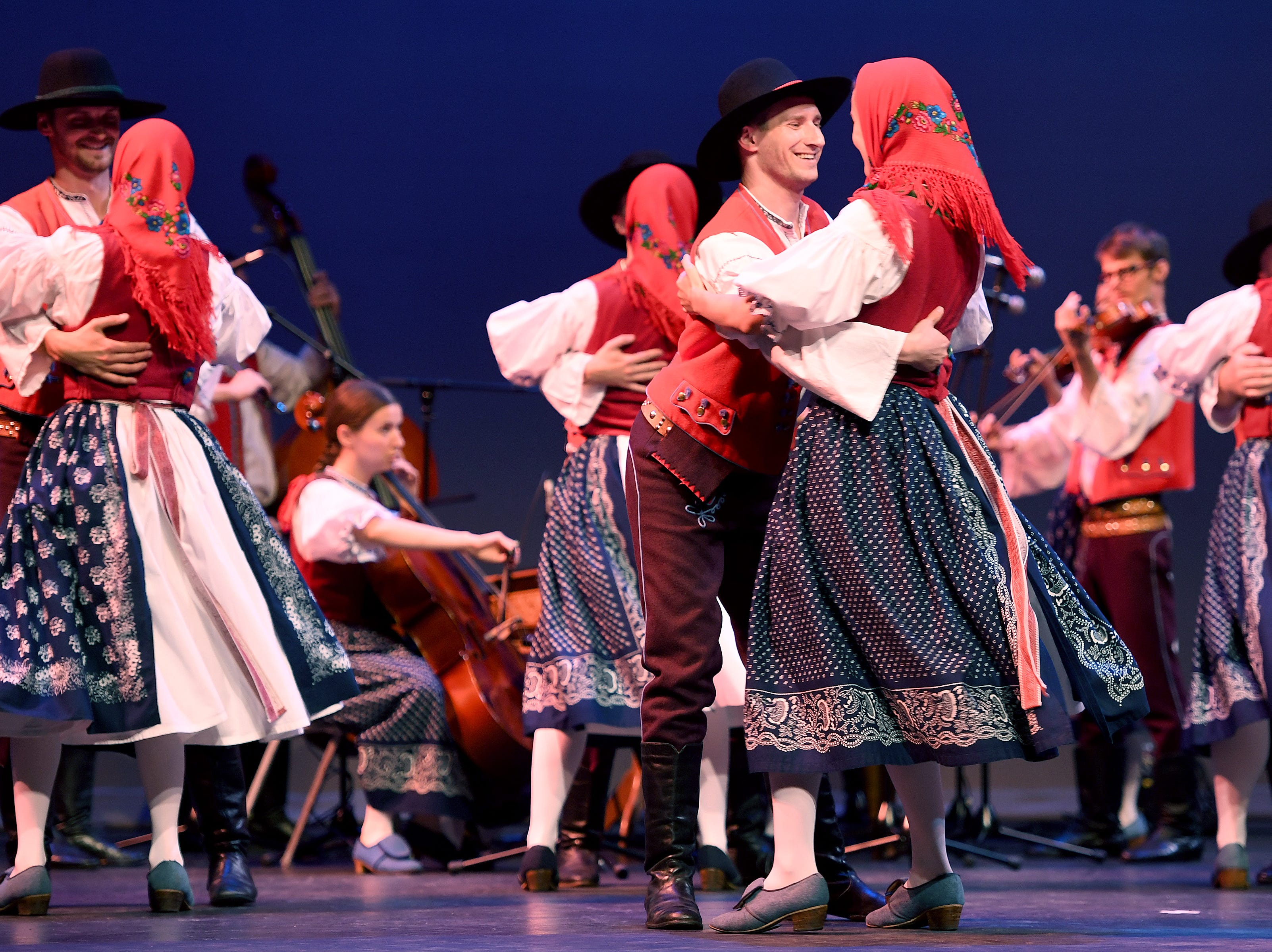 Members of the group Folk Ensemble Kašava from the Czech Republic represent their country with a dance performance during a Folkmoot Festival performance at the Diana Wortham Theatre on Friday, Aug. 27, 2018.