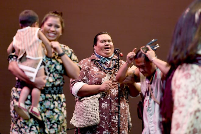 Members of the Eastern Band of Cherokee perform a buffalo dance during a Folkmoot Festival performance at the Diana Wortham Theatre on Friday, Aug. 27, 2018.