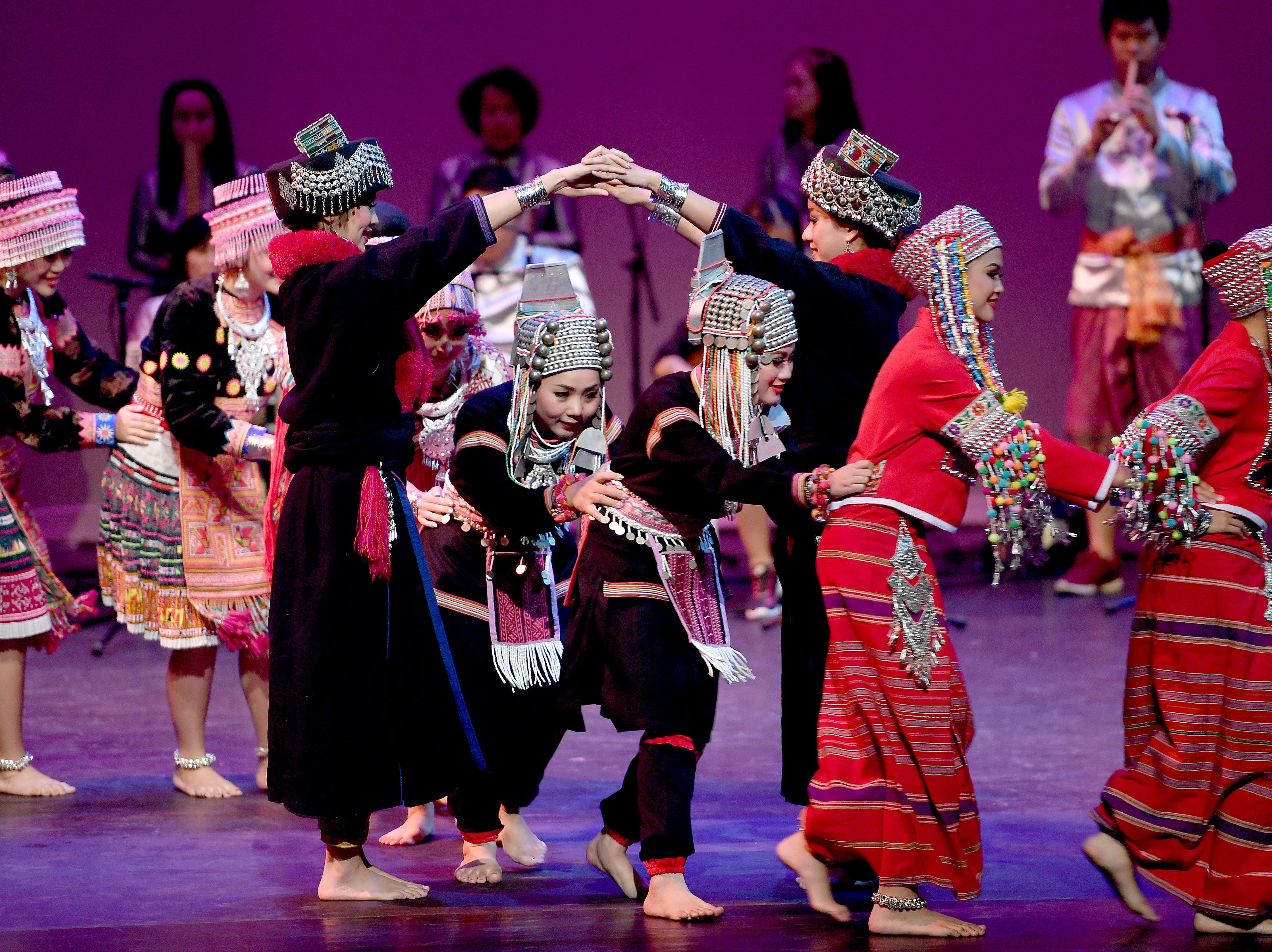 Members of Lampang Kalayanee School from Thailand perform during a Folkmoot Festival performance at the Diana Wortham Theatre on Friday, Aug. 27, 2018.