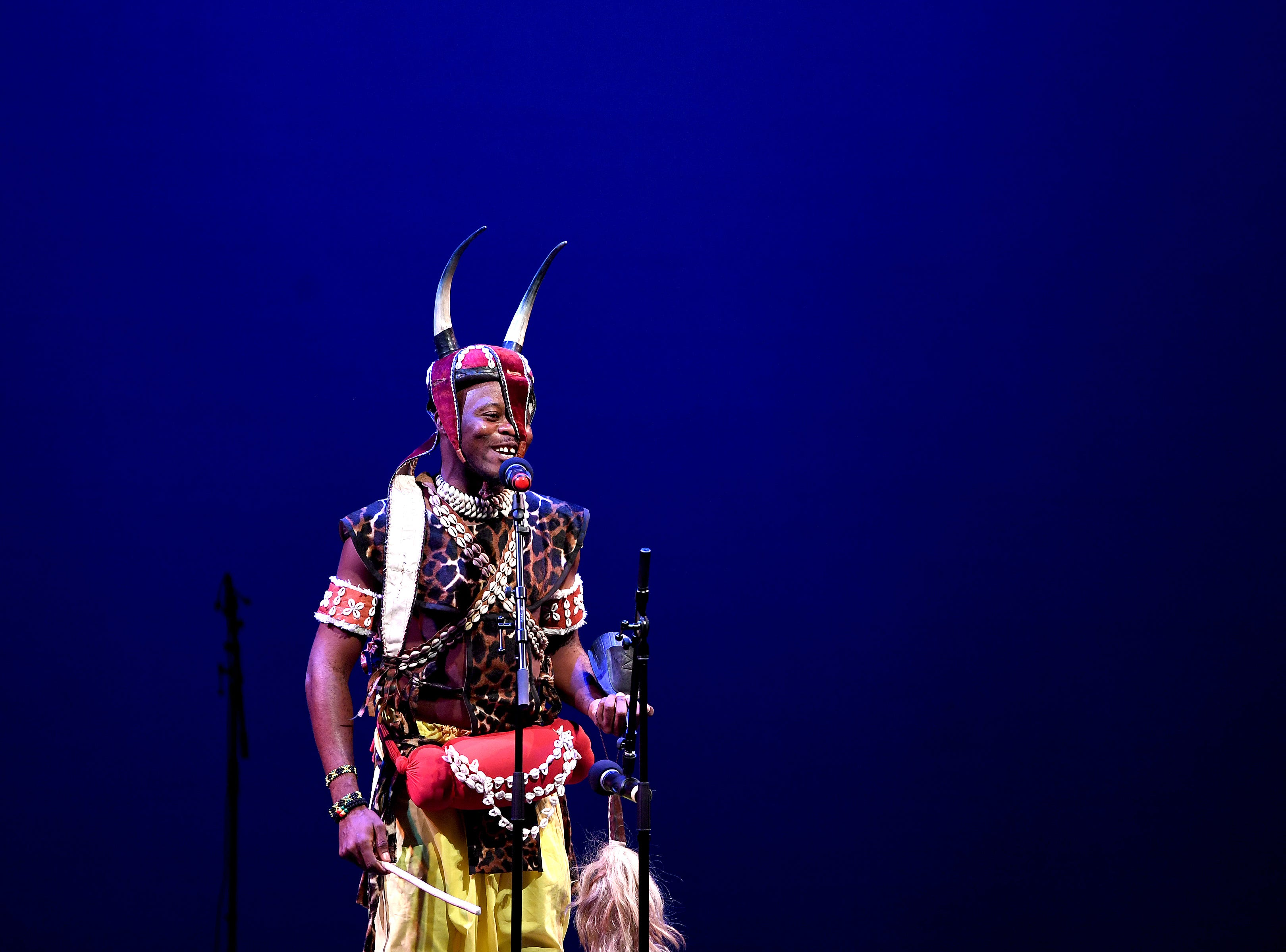 A member of the Nkrabea Dance Ensemble represents the country of Ghana in a performance on stage during a Folkmoot Festival performance at the Diana Wortham Theatre on Friday, Aug. 27, 2018.