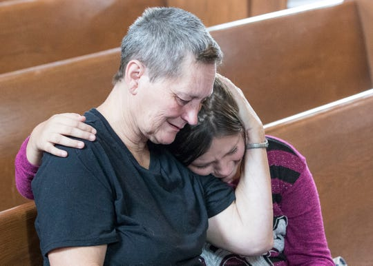 Family members of Sandy France embrace Monday afternoon as they learn about the 30-month sentence handed down to her in connection with Jason Bartley's death.
