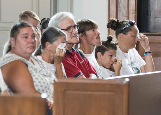 Jason Bartley's family listen as, one by one, several of them speak about how Jason's death has affected each and every family member.