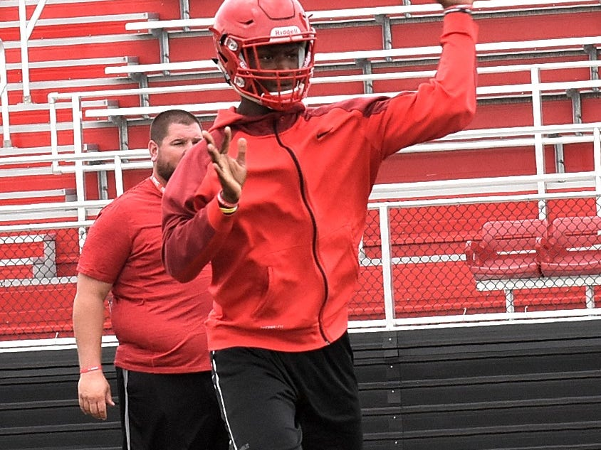 Jeff Tyus gets in some passing reps during the opening day of Fairfield football practice, July 30, 2018.