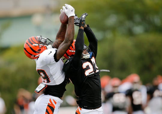 Cincinnati Bengals wide receiver Auden Tate (19) catches a pass over defensive back Dre Kirkpatrick (27) during a camp practice session at the Paul Brown Stadium practice facility in downtown Cincinnati on Monday, July 30, 2018.