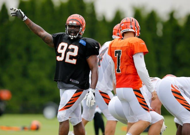 Cincinnati Bengals defensive end Chris Baker (92) calls a false start on the offense during a camp practice session at the Paul Brown Stadium practice facility in downtown Cincinnati on Monday, July 30, 2018.