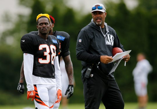Cincinnati Bengals cornerback Darius Phillips (38) watches a drill with defensive coordinator Teryl Austin during a camp practice session at the Paul Brown Stadium practice facility in downtown Cincinnati on Monday, July 30, 2018.