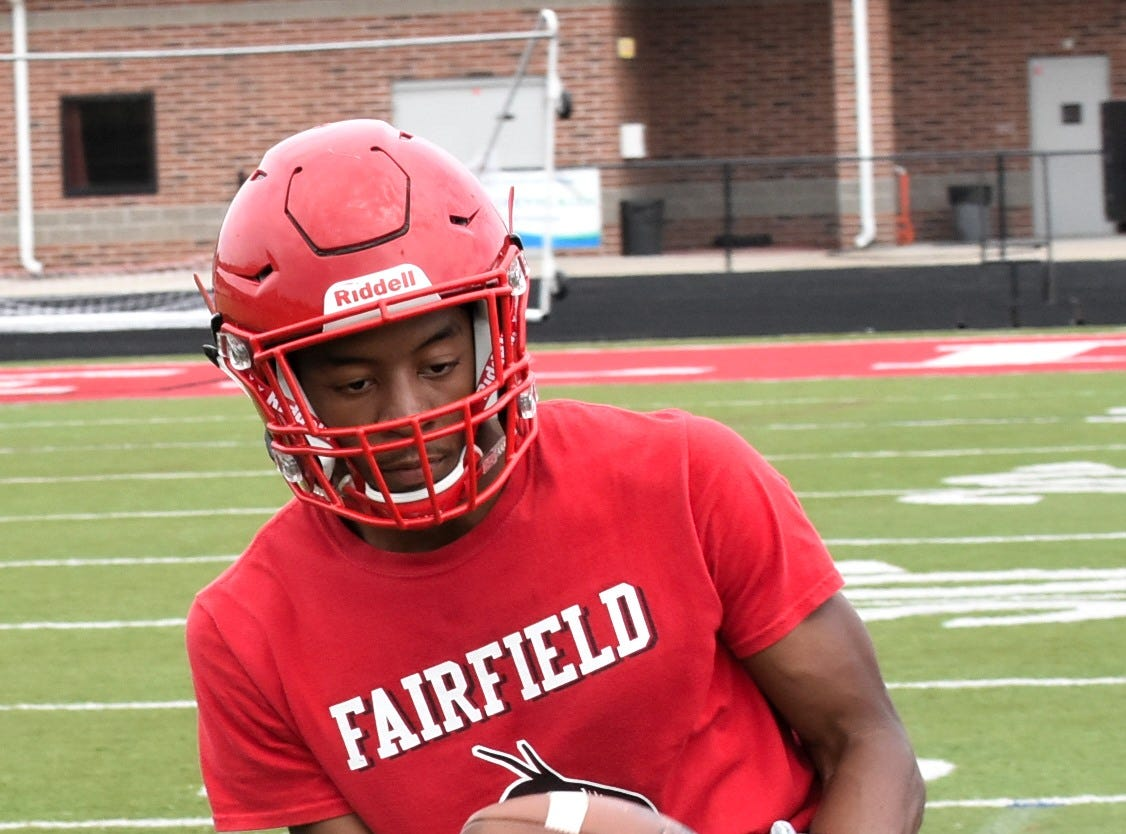 Running back Jutahn McClain looks in a pitchout during practice for the Fairfield Indians, July 30, 2018.