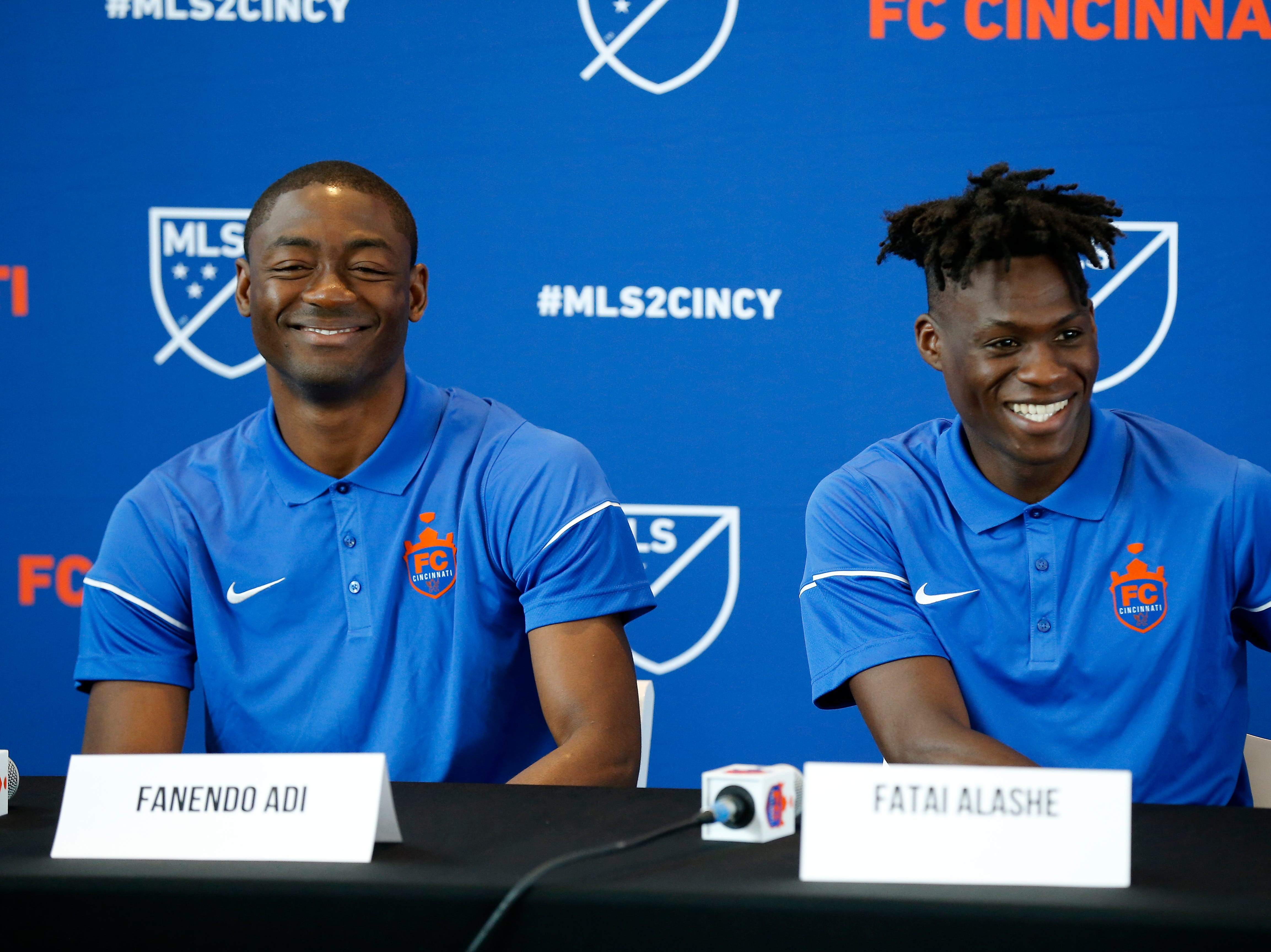 New FC Cincinnati signees Fanendo Adi and Fatai Alashe take questions during a press conference at Nippert Stadium in Cincinnati on Monday, July 30, 2018.