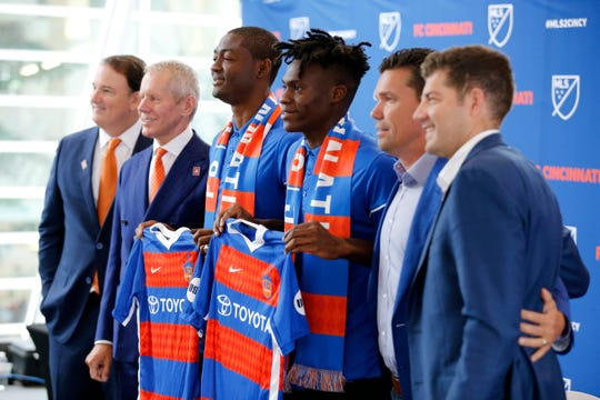 New team signees Fenando Adi and Fatai Alashe pose with (left to right) general manage Jeff Berding, owner Carl Lindner III, team manager Alan Koch and technical director Luke Sassano.