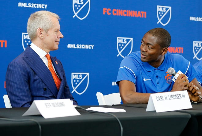 New FC Cincinnati signee Fanendo Adi takes questions and thanks team owner Carl Lindner during a press conference at Nippert Stadium.