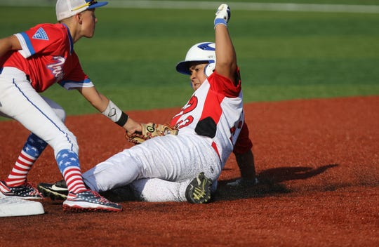 Liam Brown, of Somerset Hills, is tagged out by Sal Garcia, of Elizabeth, as he tries to stretch a single into a double in the eighth inning. Sunday, July 29, 2018