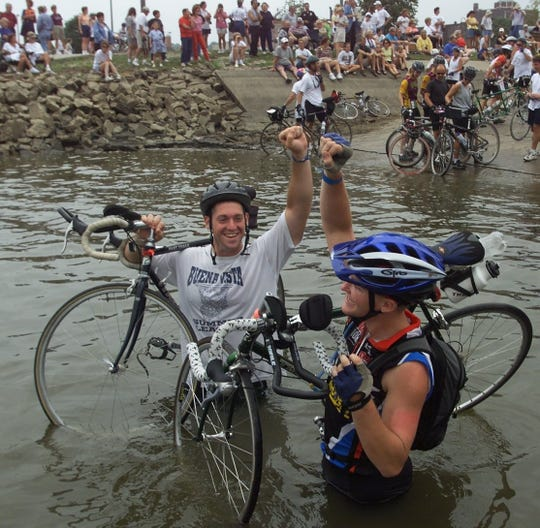From 2000: Wayne Conley of Aurelia, left, and Matt Lode of Cedar Falls, both 21, get more than their front tires wet in the Mississippi River at the close of RAGBRAI in Burlington.