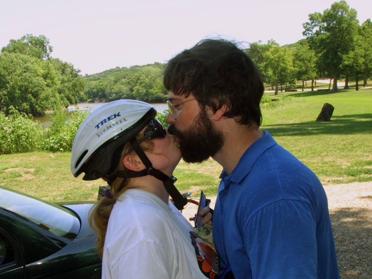 From 2002: Candy Koharchik, 36, gets a good luck kiss from husband George Koharchik in Oak Grove Park on the east bank of the Big Sioux River Saturday, July 20, 2002. The couple stopped there to dip Candy's back tire in the river, the traditional start to RAGBRAI.