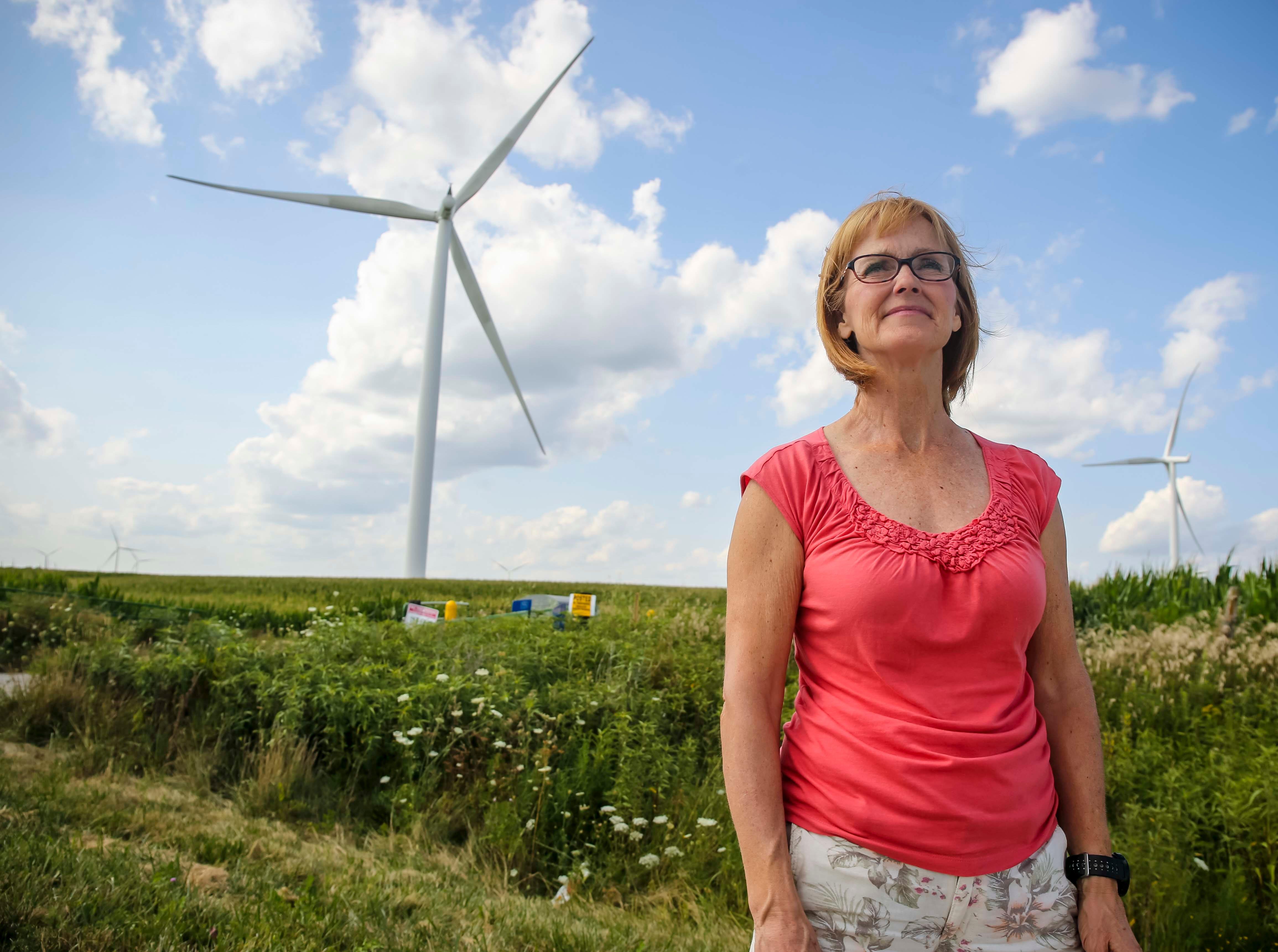Ronni Scott of rural Earlham near a  MidAmerican Energy wind turbine farm near Macksburg, Iowa, Friday, July 27, 2018.